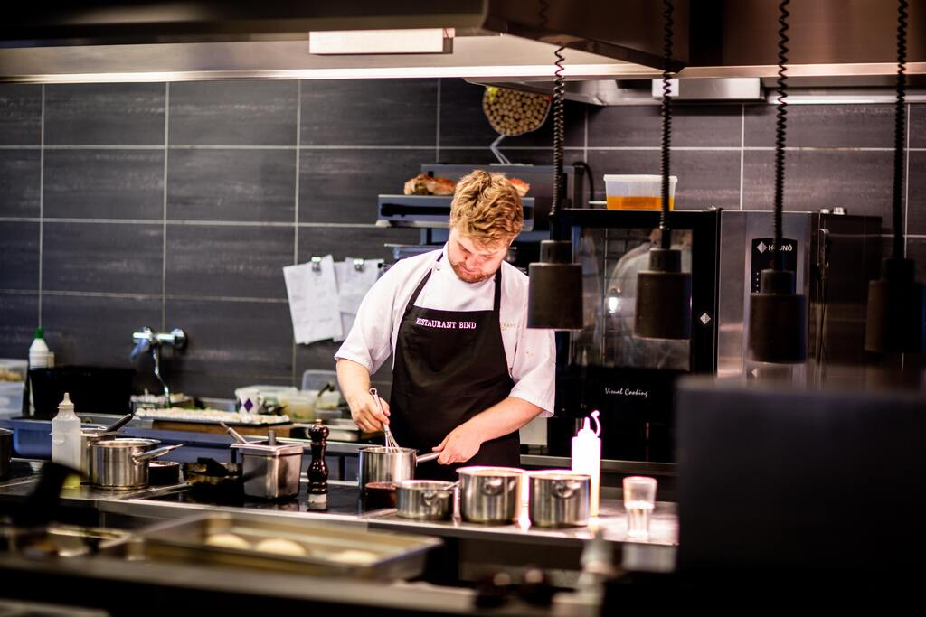 image of chef in kitchen Photo by Rene Asmussen from Pexels