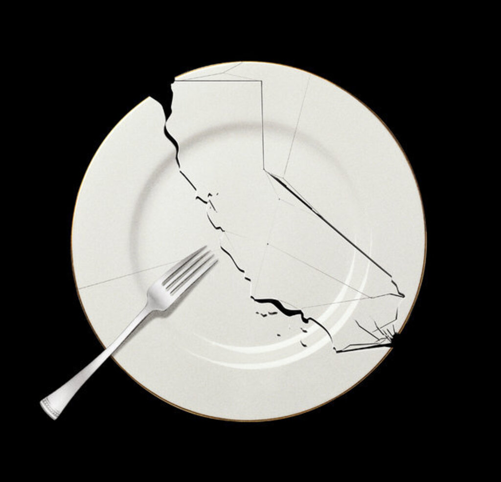 Picture of a broken plate with a fork on top